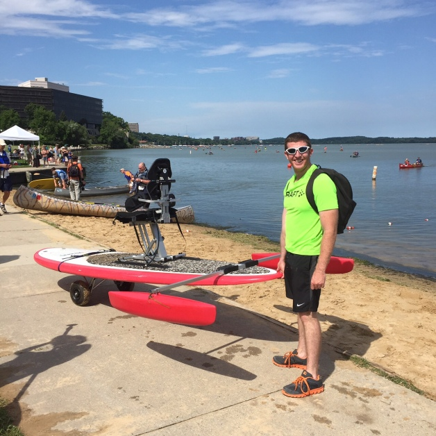 CXC Adaptive Coach Martin Donegan portaging the paddle board