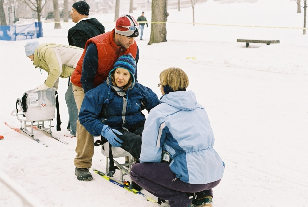 Jane Schmieding getting into a sit ski at the Madison Winter Festival