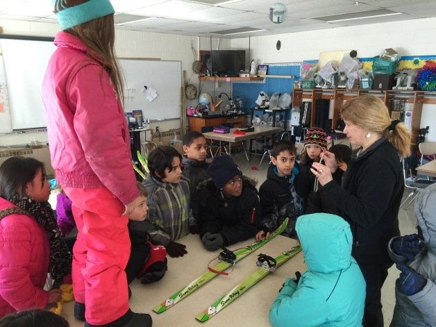 Clare Segin, explaining skis to her class at Lincoln Elementar