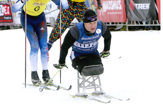 Dan Cnossen, a wounded former Navy SEAL, crosses the finish line of the American Birkebeiner Saturday in Hayward. Paul M. Walsh photo