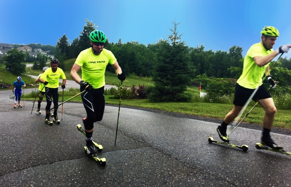 Kyle Bratrud classic rollerskiing with the boys of the NMU team nordic skiing training for olympics marquette