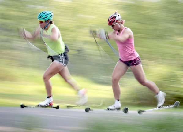 Nichole Bathe, left, Eliska Albrigtsen of the MadNorski Ski Club perform interval training exercises during an off-season workout along Carver Street in Madison, Wis., Wednesday, Aug. 2, 2017. Bathe is a member of the British national cross-country team, and Albrigtsen is a former world cup competitor for the Czech Republic and current head coach of the Norski club's youth programs. JOHN HART, STATE JOURNAL